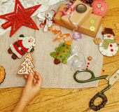 Handmade christmas gifts in mess with toys, candles, fir, ribbon, tree cone wooden vintage, post card view Stock Images