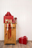 Handmade christmas gifts wrapped in red paper on wooden white ba Stock Photography
