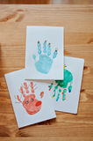 Handmade christmas handprints post cards with deer, snowman and tree Royalty Free Stock Image