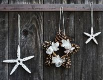 Handmade Christmas ornaments. Hanging on the rope on the rustic wooden background. Selective focus Royalty Free Stock Images