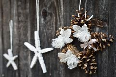 Handmade Christmas ornaments. Hanging on the rope on the rustic wooden background. Selective focus Royalty Free Stock Image