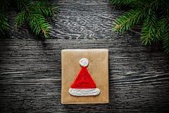 Handmade Christmas present box pine tree branch holidays concept.  Stock Photo