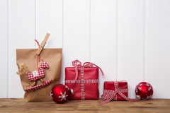 Handmade christmas presents wrapped in paper with red white chec Royalty Free Stock Images