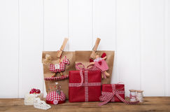 Handmade christmas presents wrapped in red paper with checked ri Stock Image