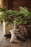 Handmade Christmas sock and basket of pines and cones Royalty Free Stock Image