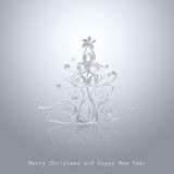 Handmade Christmas tree cut out from office paper. Quilling art Stock Photography