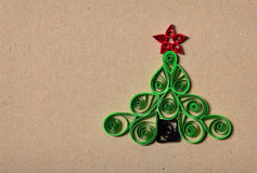 Handmade Christmas tree cut out from paper. Quilling Stock Image