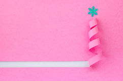 Handmade Christmas tree cut out from pink paper. Royalty Free Stock Image