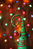 Handmade Christmas tree decoration against lights blurred backg Royalty Free Stock Images