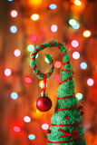 Handmade Christmas tree decoration against lights blurred backg Royalty Free Stock Photos