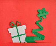 Christmas tree and gift. Handmade Christmas tree and gift on red background stock images