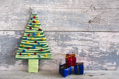 Handmade christmas tree and three bows Royalty Free Stock Photos