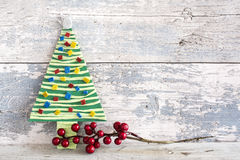 Handmade christmas tree and three bows Stock Image