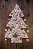 Handmade christmas tree of wood decorated with gingerbread. Stock Photo
