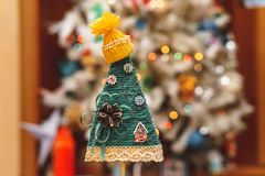 Handmade Christmas tree in a yellow hat royalty free stock images