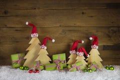 Handmade christmas trees carved and apple green christmas presen Royalty Free Stock Image