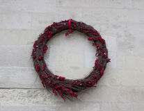 Handmade Christmas wreath hanging on granite wall for holiday royalty free stock images