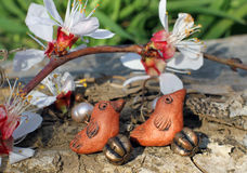 Handmade clay bird earrings on the nature background Stock Photo