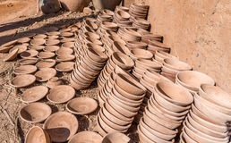 Handmade clay bowls stacked in columns, pottery workshop Royalty Free Stock Images