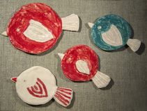 Handmade clay dishes. A series of colourful handmade clay dishes with bird motif Stock Photo