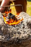 Handmade clay horn burning coals firewood metal preparation for forging and melting drawing weapons traditional way royalty free stock photography