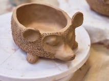 Handmade clay pot made of fireclay. Hedgehog. stock photo