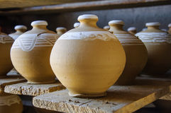 Handmade clay pots. Some handmade clay pots on desk royalty free stock photography