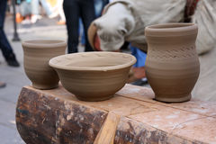 Handmade clay pottery. On display a busy street Stock Photo