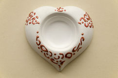 Handmade clay pottery stand candle in the form of heart Stock Photography
