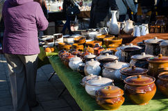 Handmade clay varnish pots with lids at rural fair Stock Photography