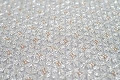 Handmade cloth made from silver and rose gold beads. Royalty Free Stock Photography