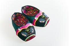 Handmade cloth shoes Stock Photos