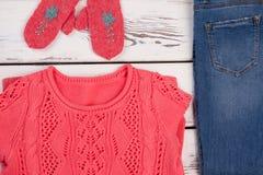 Handmade clothes and denim pants Stock Photos