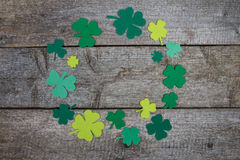 Handmade clover leaves laid out on table in form of circle Stock Images