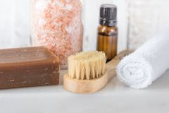 Handmade Coal Tar Soap Pink Himalayan Salt Essential Oil Towel Brush on White Marble Background. Spa Wellness Relaxation Body Care Stock Photo