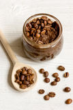 Handmade coffee-cocoa scrub on wooden background close up Royalty Free Stock Images