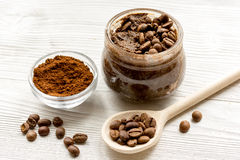 Handmade coffee-cocoa scrub on wooden background close up Royalty Free Stock Photo