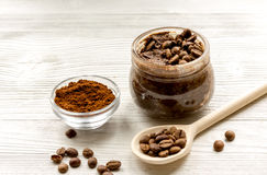 Handmade coffee-cocoa scrub on wooden background Royalty Free Stock Images