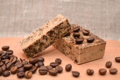Handmade coffee natural soap on wooden background. Stock Photography