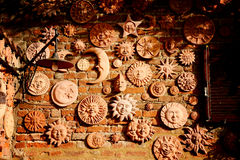Handmade collection of terracotta sun decoration.  Stock Image