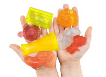 Handmade color pieces of soap in kids palms Royalty Free Stock Photography