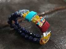 Handmade colorful beaded women`s wristbands royalty free stock image