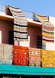 Handmade colorful carpets and rugs hanged on balcony African hou Royalty Free Stock Photo