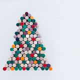 Handmade Christmas tree made from wine cork on white background with free space. Handmade colorful Christmas tree made from wine cork on white background with Royalty Free Stock Photos