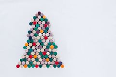 Handmade Christmas tree made from wine cork on white background with free space. Handmade colorful Christmas tree made from wine cork on white background with Stock Photos