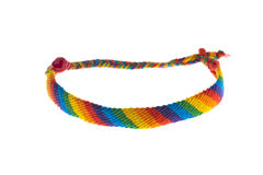Handmade colorful gay-lesbian bracelet. Handmade colorful macrame gay-lesbian bracelet with stripes in the colors of the rainbow or spectrum symbolising sexual Stock Photography