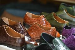 Handmade colorful luxury man shoes in a factory. stock images
