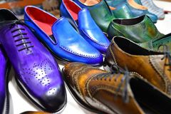 Handmade colorful luxury man shoes in a factory. stock photography