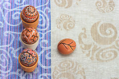 Handmade colorful painted easter egg against matching tablecloth Royalty Free Stock Photography