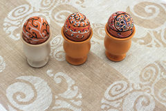 Handmade colorful painted easter egg against matching tablecloth Royalty Free Stock Image